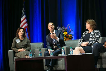 Panel moderator Angela Evans, along with panelists Julian Castro and Carol Naughton