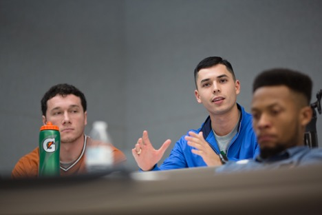 A student asks a question in the immigration reform panel
